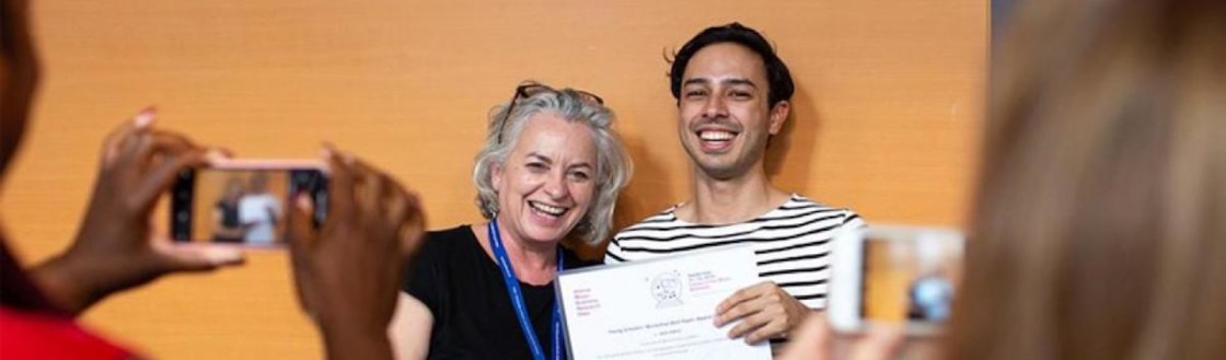 student-receiving-award-at-young-scholars-workshop